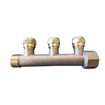Image of   fordelerrør 3/4'' med 3x1/2'' grene inkl. 15 mm omløber. Bronze